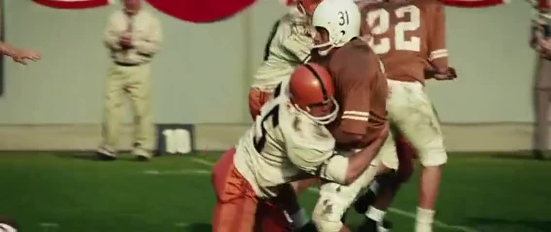 Another walloping tackle by Syracuse's Bob Lundy.