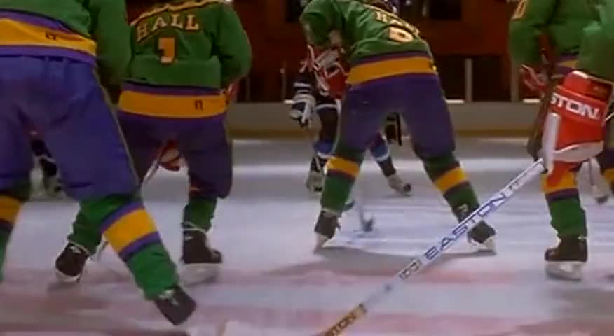 Terry Hall, with the puck, moves the puck ahead to brother Jesse.