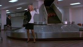 I'm - I'm at the baggage claim.