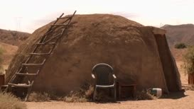 inside George Sr.'s desert sweat lodge...