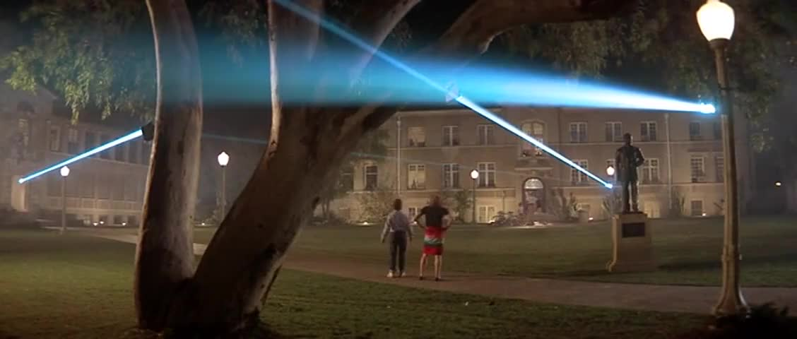 - What's this? - It's a laser beam, bozo.