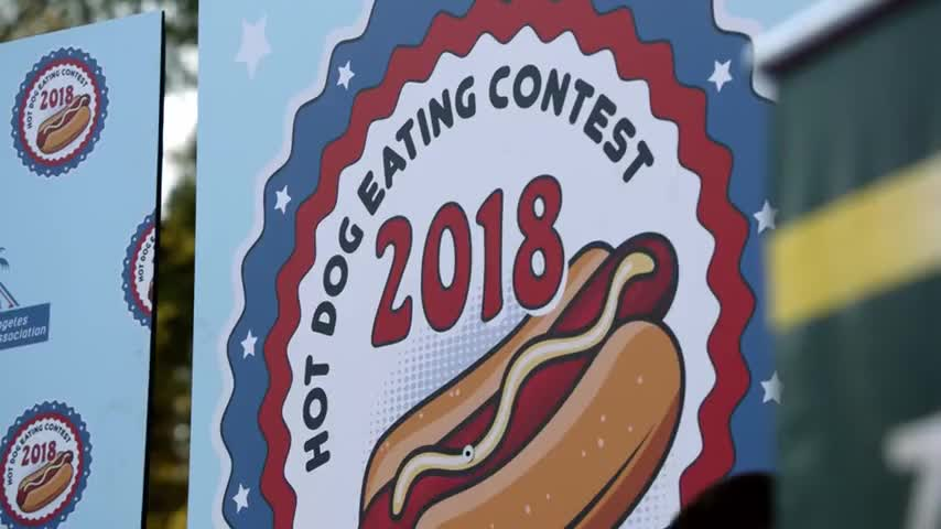 Announcer: The hot dog contest is about to begin.