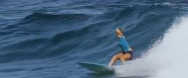 Bethany Hamilton duck dives under Malina Birch