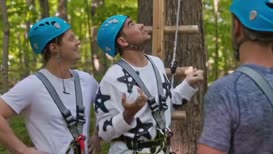 20 feet in the air on a series of shaky logs.